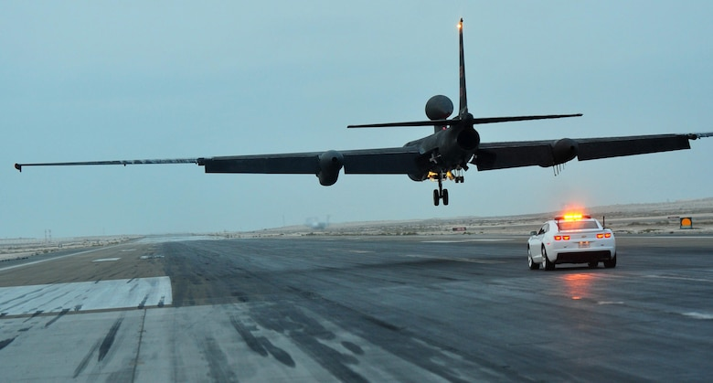 A mobile chase car driver pursues a U-2 Dragon Lady reconnaissance aircraft during its landing at an undisclosed location in Southwest Asia, Dec. 7, 2015. Mobile chase car drivers act as a second pair of eyes and ears for U-2 pilots during their launch and landings, radioing adjustments to the aircraft to make up for the pilot's limited sight of the runway. (U.S. Air Force photo by Staff Sgt. Kentavist P. Brackin)