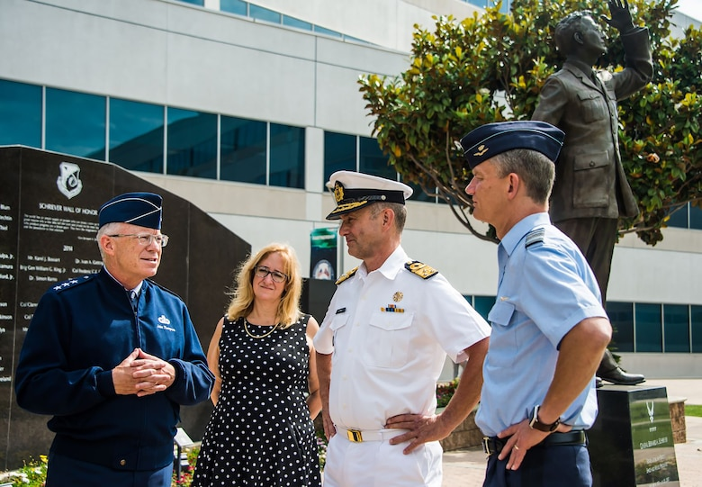 U.S. Air Force Lt. Gen. John F. Thompson, Space and Missile Systems Center commander and Air Force Program executive officer for Space, and Deanna Ryals, Chief Partnership Officer, meet with Vice Admiral Aire de Waard, the Netherlands director of Defence Material Organization, and Lt. Gen. Dennis Luyt, commander of the Royal Netherlands Air Force, before the start of an international partnership meeting at Los Angeles Air Force Base, California, July 8, 2021. The U.S. government is looking to broaden collaboration and partnerships with the Netherlands in several military space mission areas growing from our strong collaboration in MILSATCOM and responsive space capabilities. (U.S. Space Force photo by Van Ha)