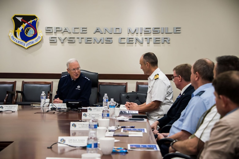 U.S. Air Force Lt. Gen. John F. Thompson, Space and Missile Systems Center commander and Department of the Air Force Program Executive Officer for Space, left, and attendees of an international partnership meeting discuss current and future military space efforts at Los Angeles Air Force Base, California, July 8, 2021. The U.S. Space Force recognizes the potential for cooperative agreements, joint capability development, and increased Dutch contribution to the NATO Alliance as an area favorable for engagement by U.S. and other allied stakeholders who seek to ensure space superiority. (U.S. Space Force photo by Van Ha)