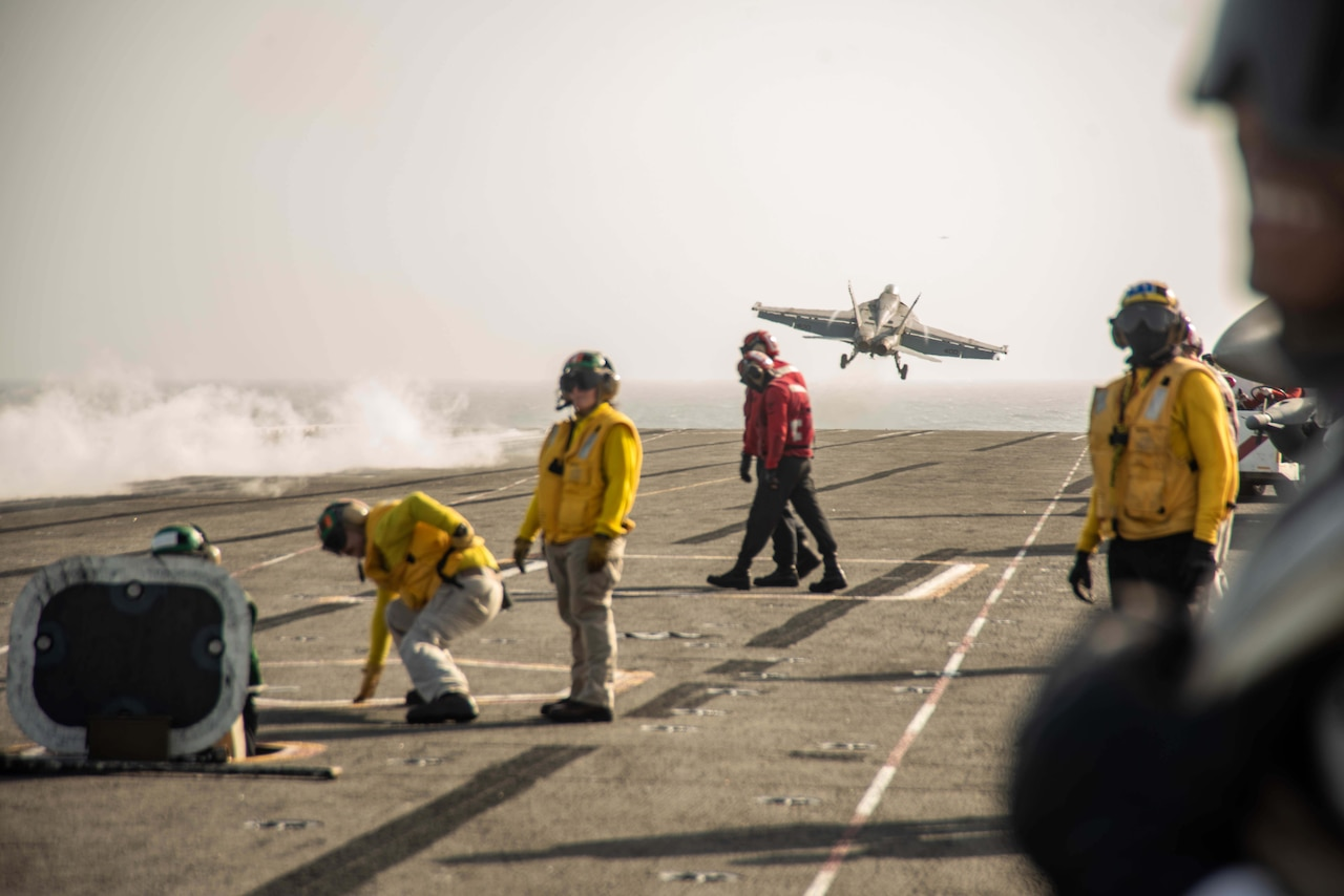 A jet takes off from a carrier.