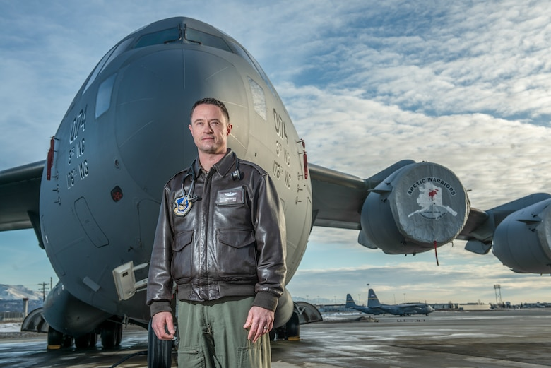 Maj. Chris Backus, a pilot-physician, stands in front of his airframe, a C-17 Globemaster III, on Joint Base Elmendorf-Richardson, Alaska, March 9, 2016. Pilot-physicians are involved in the research, development, testing, and evaluation of new and current Air Force systems and missions. Because of unique medical and human factors qualifications, pilot-physicians are particularly well suited to help develop new aircraft, life support equipment, and avionics or software upgrades. This is accomplished to enable aircrews to better adapt to the change in mission requirements. Backus is currently assigned to the 673rd Medical Group. (U.S. Air Force photo/Master Sgt. Brian Ferguson)