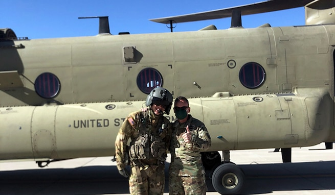 1st Lt. Bradley Cho, a platoon leader at Company B, 2-501 General Support Aviation Battalion, left, and his father-in-law, Lt. Gen. Daniel Karbler, commanding general, U.S. Army Space and Missile Defense Command, pose for a photo just before Cho flies Karbler from Fort Bliss, Texas, to White Sands Missile Range, New Mexico, April 7. (U.S. Army photo)