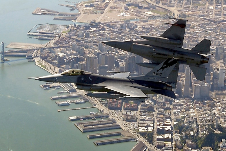 Two F-16 Fighting Falcons begin to roll into position for a rapid decent during an Operation Noble Eagle training patrol over San Francisco, Calif. The F-16s are assigned to the California Air National Guard's 144th Fighter Wing in Fresno, Calif.  (U.S. Air Force photo by Master Sgt. Lance Cheung)