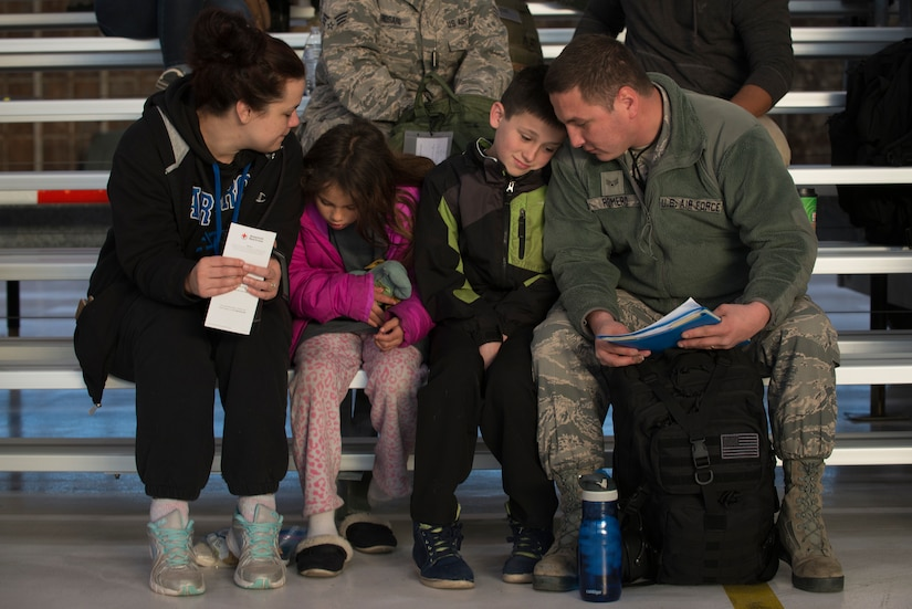 Senior Airman Aaron Romero from the Colorado Air National Guard's 140th Maintenance Group, spends time with his family before he departs from Buckley AFB, Colo., May 5, 2017. Approximately 250 Airmen from the Colorado Air National Guard's 140th Wing along with 12 F-16 Fighting Falcons are departing to Kadena Air Base, Japan for a deployment in support of the U.S. Pacific Command Theater Security Package.   (U.S. Air National Guard photo by Master Sgt. Wolfram M. Stumpf/Released)