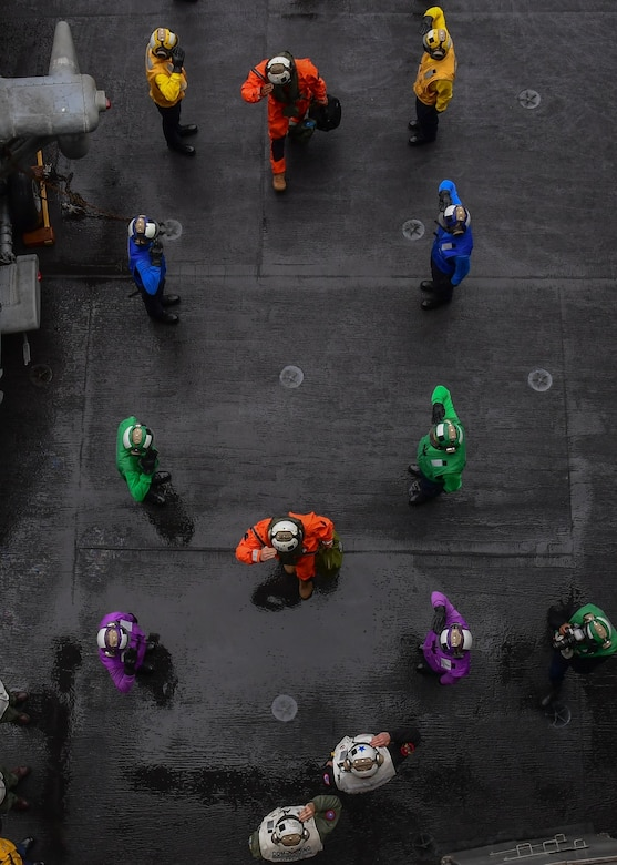 U.S. Air Force Gen. Ken Wilsbach, commander, Pacific Air Forces, shown here in the orange flight suit near the bottom, passes through ceremonial side-boys aboard the aircraft carrier USS Theodore Roosevelt (CVN 71), May 10, 2021, in the Gulf of Alaska during Exercise Northern Edge 2021 (NE21). NE21 is one in a series of U.S. Indo-Pacific Command exercises designed to sharpen the joint forces' skills; to practice tactics, techniques, and procedures; to improve command, control, and communication relationships; and to develop cooperative plans and programs. Approximately 15,000 U.S. service members are participating in a joint training exercise hosted by U.S. Pacific Air Forces May 3-14, 2021, on and above the Joint Pacific Alaska Range Complex, the Gulf of Alaska, and temporary maritime activities area. (U.S. Navy photo by Mass Communication Specialist Seaman Apprentice Juan J. Ruiz-Lazcano)