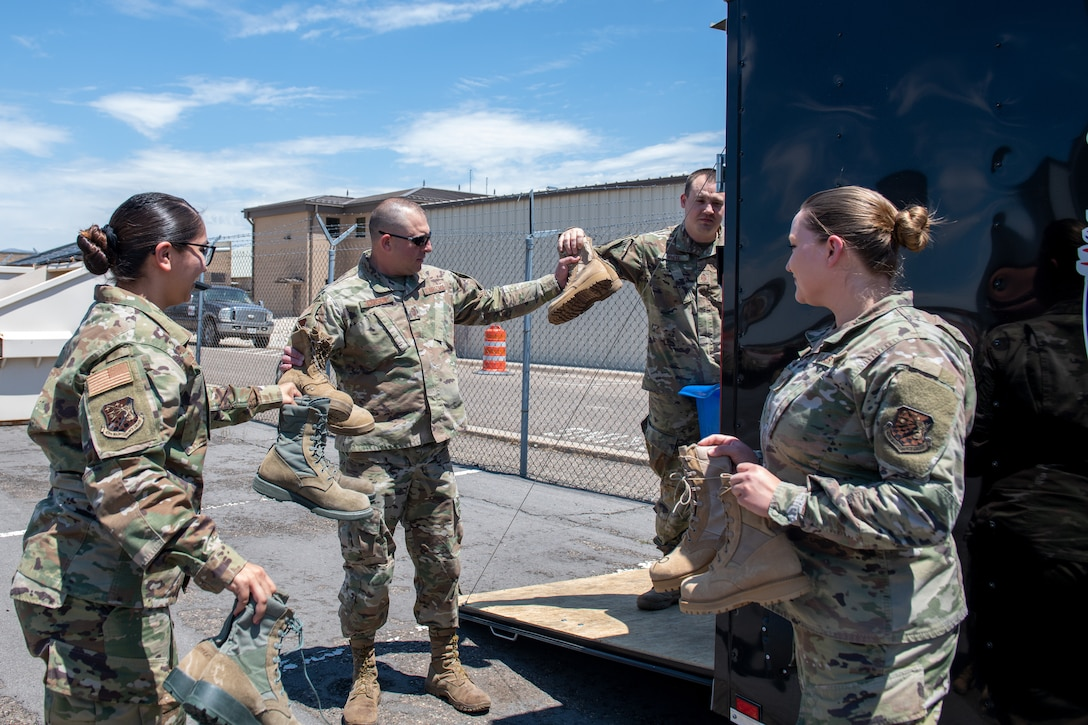 Airmen from the 419th and 388th Fighter Wings load a trailer with boots for a boot drive at Hill Air Force Base, Utah, on July 7, 2021.