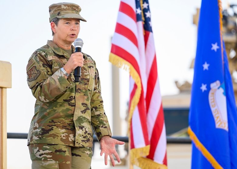 Col. David Briggs, outgoing 378th Expeditionary Mission Support Group commander, addresses the crowd during the group change of command ceremony, Prince Sultan Air Base July 5, 2021. The 378th EMSG provides full spectrum support to the 378th Air Expeditionary Wing and joint partners, sustaining and defending forces to enable combat power projection in the region. (U.S. Air Force photo by Senior Airman Samuel Earick)