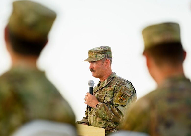 U.S. Air Force Col. David Briggs, outgoing 378th Expeditionary Mission Support Group commander, addresses the crowd during the unit change of command ceremony, Prince Sultan Air Base, July 5, 2021. The 378th EMSG provides full spectrum support to the 378th Air Expeditionary Wing and joint partners, sustaining and defending forces to enable combat power projection in the region. (U.S. Air Force photo by Senior Airman Samuel Earick)