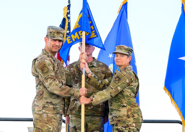 U.S. Air Force Col. Heidi Paulson, incoming 378th Expeditionary Mission Support Group commander, accepts command of the 378th EMSG from Brig. Gen. Robert Davis, 378th Air Expeditionary Wing commander, during the group change of command ceremony, Prince Sultan Air Base, July 5, 2021. The 378th EMSG provides full spectrum support to the 378th AEW and joint partners, sustaining and defending forces to enable combat power projection in the region. (U.S. Air Force photo by Senior Airman Samuel Earick)