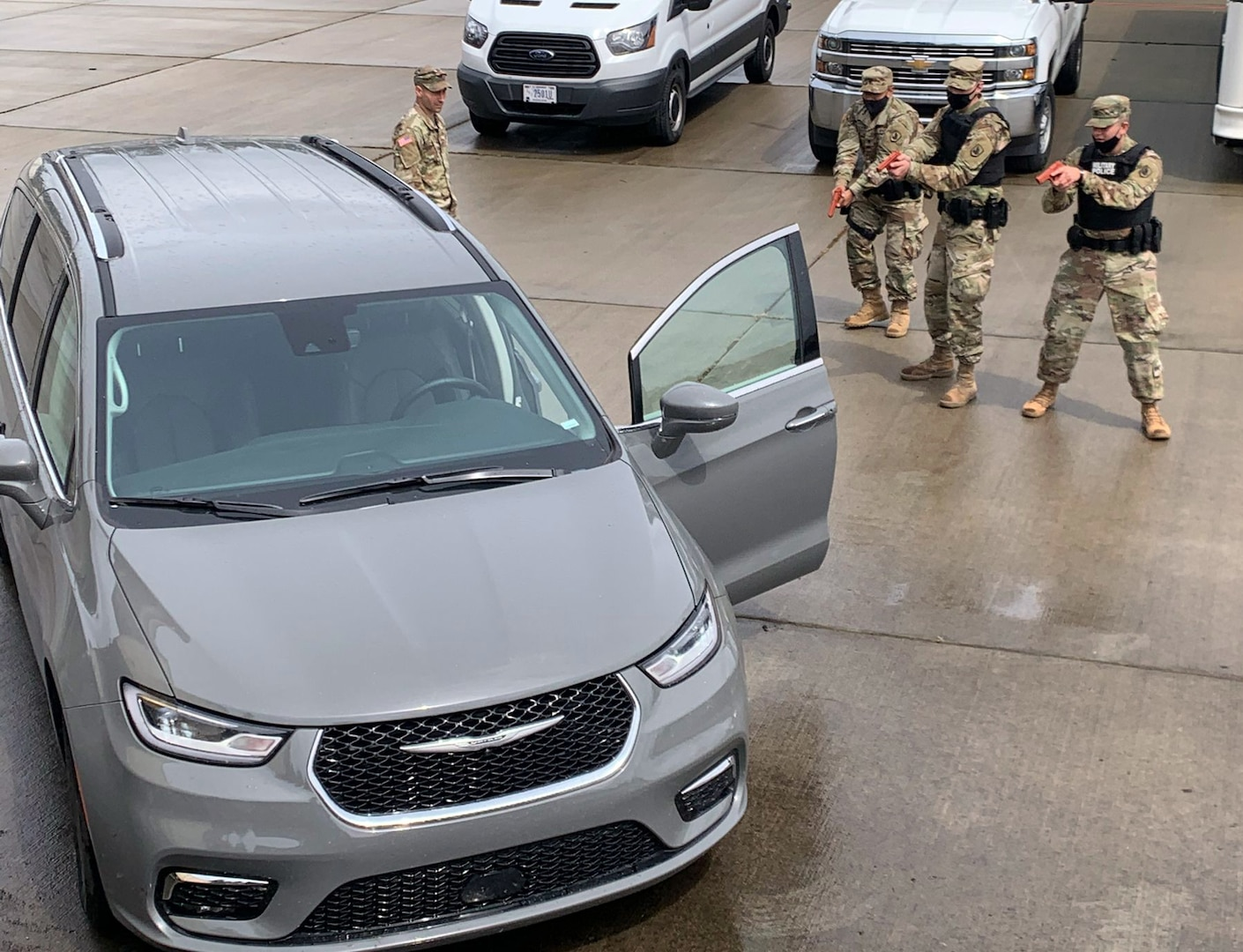 Washington National Guard Soldiers with the 506th Military Police train on a high-risk traffic stop as part of their annual training June 14, 2021, at Camp Murray, Wash. The 506th Military Police focused annual training this year on developing the skills of newer Soldiers.