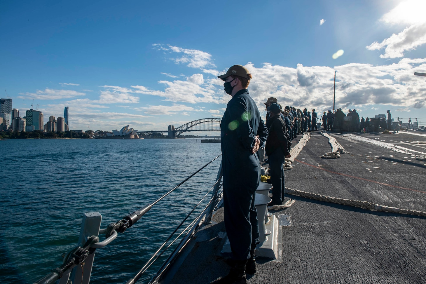210703-N-HG846-1177 SYDNEY (July 3, 2021) – Sailors man the rails aboard Arleigh Burke-class guided-missile destroyer USS Rafael Peralta (DDG 115) as they enter Sydney Harbor for Pacific Vanguard 2021. Pacific Vanguard, an exercise involving U.S., Australian, Republic of Korea navies and Japan Maritime Self Defense Force, is designed to strengthen maritime operations in the multilateral environment. (U.S. Navy photo by Mass Communication Specialist 3rd Class Daniel Serianni)