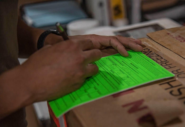 Staff Sgt. Cullen Sullivan, 379th Expeditionary Medical Support Squadron medical laboratory technician, fills out a blood shipment information sheet July 1, 2021, at Al Udeid Air Base, Qatar.