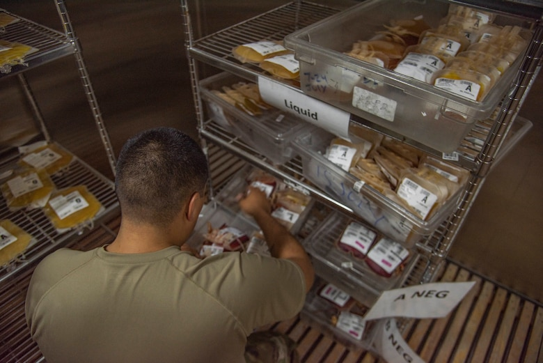 Tech. Sgt. Miguel Davila, 379th Expeditionary Medical Support Squadron medical logistics technician, sorts through bags of blood July 1, 2021, at Al Udeid Air Base, Qatar.