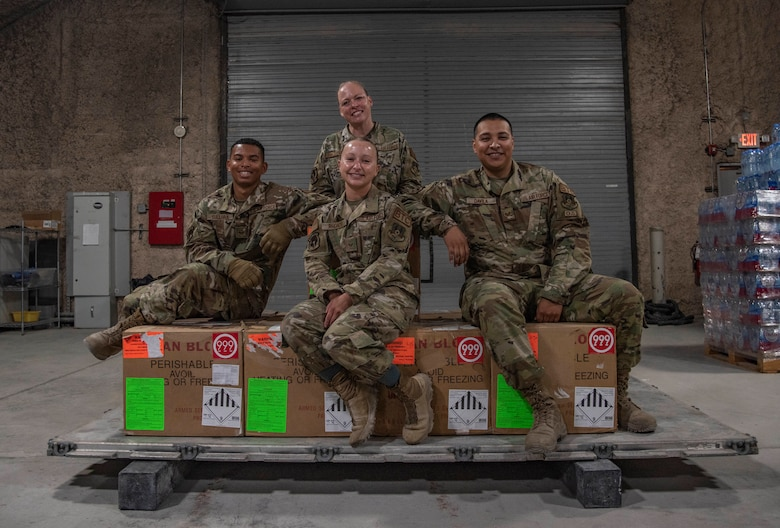 The Blood Transshipment Center team pose for a picture July 1, 2021, at Al Udeid Air Base, Qatar.