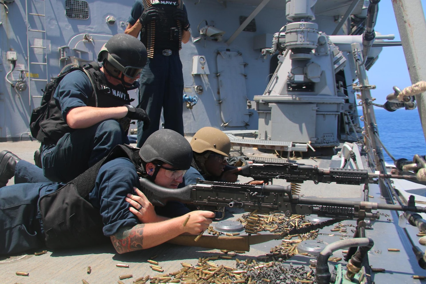 (July 4, 2021) Sailors aboard the Arleigh Burke-class guided-missile destroyer USS Donald Cook (DDG 75) man M240 machine guns during live fire gunnery exercises,  July 04, 2021. Donald Cook is on a scheduled deployment in the U.S. Sixth Fleet area of operations in support of U.S. national interests and security in Europe and Africa.