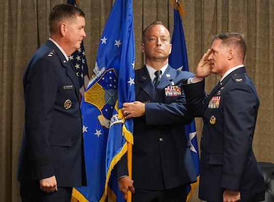 Lt. Gen. Kirkland (left) receiving salute from Col. Sebren (right).