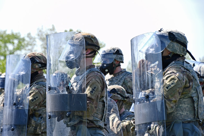 U.S. Army and Air National Guardsmen participate in a Civil Disturbance Unit training event with Capitol Police at the Park Police training grounds in Washington, D.C., April 27, 2021. Since January, Army and Air National Guard units from around the country have provided ongoing security, communication, medical, evacuation, logistical and safety support to capital civil authorities. (U.S. Air National Guard photo by Staff Sgt. Hanna Smith)