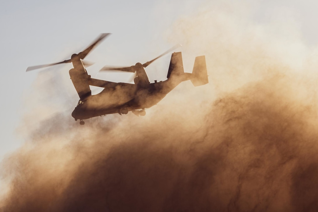 210620-M-JU875-1002 TABUK, Saudi Arabia (June 20, 2021) - An MV-22B Osprey tiltrotor aircraft, attached to the 24th Marine Expeditionary Unit (MEU), takes off to conduct parachute operations during a theater amphibious combat rehearsal (TACR) in Tabuk, Kingdom of Saudi Arabia, June 20. TACR integrates U.S. Navy and Marine Corps assets to exercise a range of critical combat-related capabilities, both afloat and ashore. 24th MEU is deployed to the U.S. 5th Fleet area of operations in support of naval operations to ensure maritime stability and security in the Central Region, connecting the Mediterranean and Pacific through the western Indian Ocean and three strategic choke points. (U.S. Marine Corps photo by Cpl. Davis Harris)