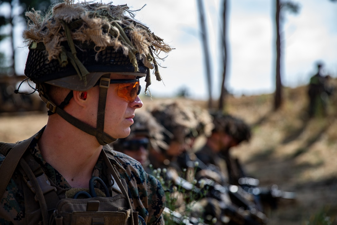 U.S. Marine Corps Sgt. Ethan Davis, a native of Orlando, Fla. and a squad leader with Alpha Company, 1st Battalion, 6th Marine Regiment, 2d Marine Division, prepares to start a squad-level live-fire training event during Exercise Sea Breeze 21 in a nondisclosed location on July 3, 2021. Exercise Sea Breeze is an annual event that brings together military units from several countries, and within 2d Marine Expeditionary Force, to enhance their warfighting capabilities and build strong relationships. (U.S. Marine Corps photo by Lance Cpl. Jacqueline Parsons)