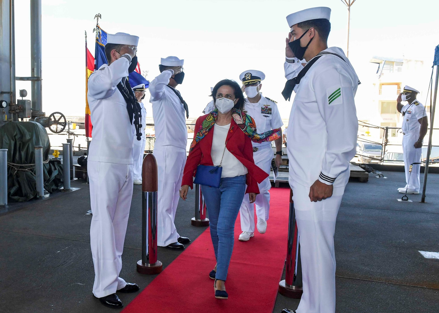 """(July 8, 2021) Spanish Minister of Defense Margarita Robles walks through the side boys before receiving a tour aboard the Expeditionary Sea Base USS Hershel """"Woody"""" Williams (ESB 4) in the Atlantic Ocean, July 8, 2021. Hershel """"Woody"""" Williams is on a scheduled deployment in the U.S. Sixth Fleet area of operations in support of U.S. national interests and security in Europe and Africa."""