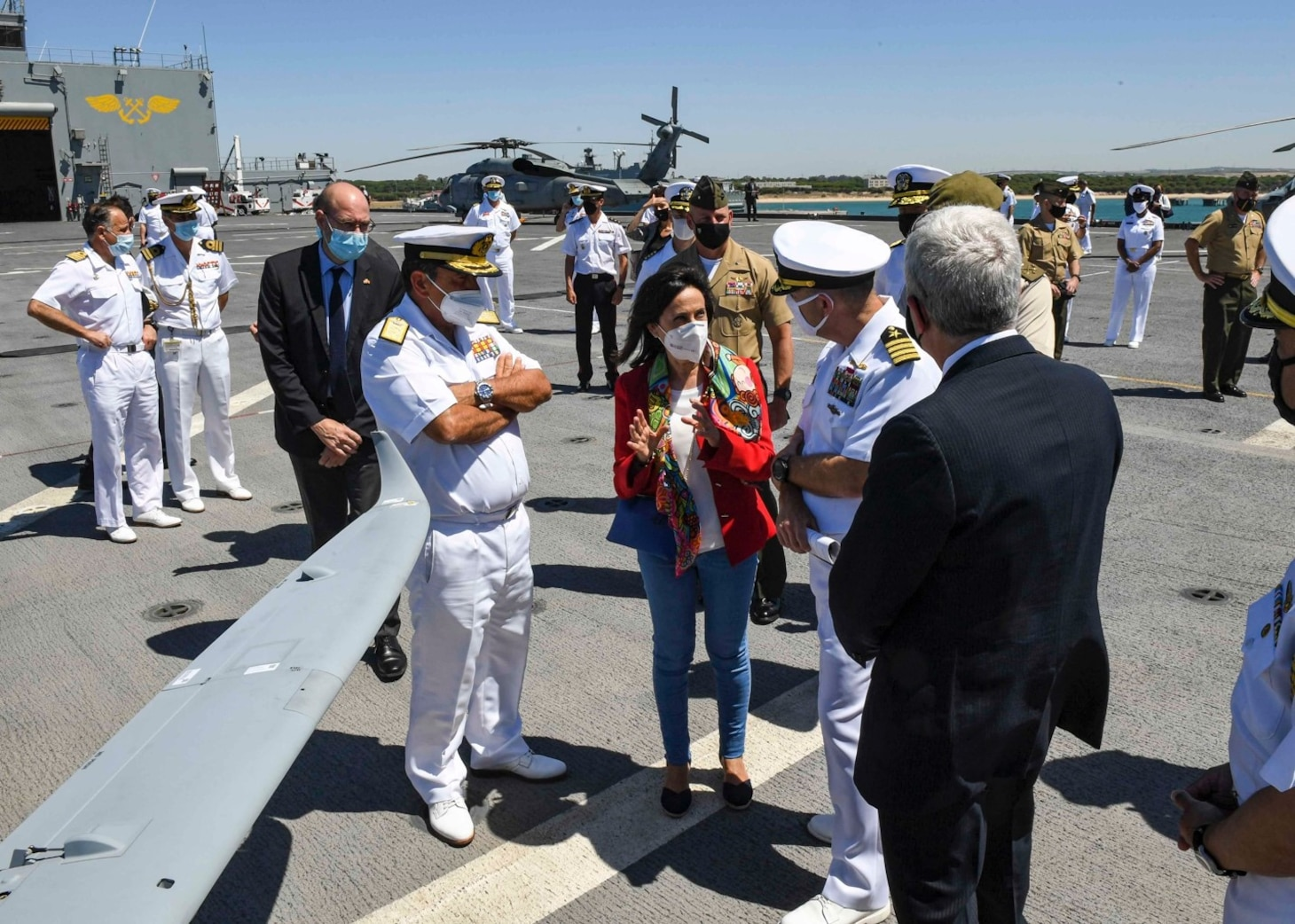 """(July 8, 2021) Spanish Minister of Defense Margarita Robles, center, speaks with Capt. Michael Concannon, commanding officer, right, about the ship's flight deck capabilities during a tour aboard the Expeditionary Sea Base USS Hershel """"Woody"""" Williams (ESB 4) in the Atlantic Ocean, July 8, 2021. Hershel """"Woody"""" Williams is on a scheduled deployment in the U.S. Sixth Fleet area of operations in support of U.S. national interests and security in Europe and Africa."""
