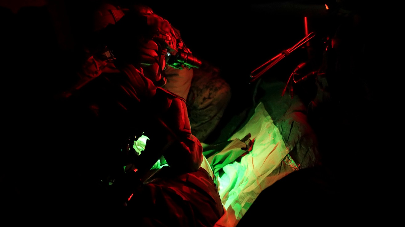 A Marine Raider photographs a simulated detainee during a RAVEN unit readiness exercise in Nashville, Tenn., May 11, 2021. RAVEN is a training exercise held to evaluate all aspects of a Marine Special Operations Company prior to a Marine Forces Special Operations Command deployment. (U.S. Marine Corps photo by Cpl. Brennan Priest)