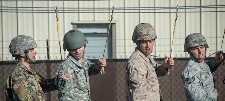 Joint Communication Support Element (JCSE) operators go through parachute drills