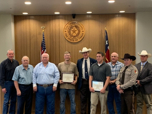 17th Security Forces Squadron police officer, Bradley Smelt, poses for a photo with members of Tom Green Country Sherriff's Office in San Angelo, Texas. Smelt helped a Tom Green Country Sherriff Deputy in apprehending a fugitive, on May 18 and received the Sheriff's Award for going above and beyond his duty as a citizen. (Courtesy Photo)
