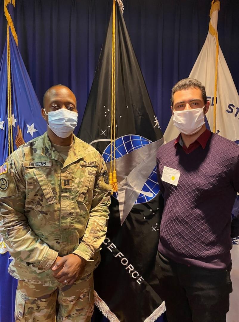 Capt. Preston Giddens, New York MEPS operations officer, presiding officer for the Oath of Enlistment with new recruit Fernando Lopez