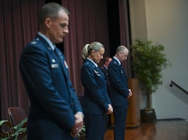 The official party attending the graduation of Specialized Undergraduate Pilot Training class 21-12 lower their heads in prayer July 9, 2021, on Columbus Air Force Base, Miss. The invocation was given by Chaplain (Capt.) Joshua Stevens after the National Anthem was played. (U.S. Air Force photo by Airman First Class Jessica Haynie)