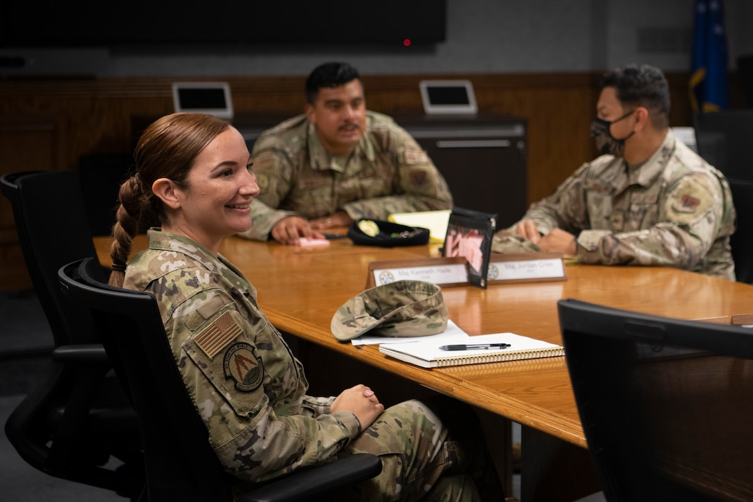 U.S. Air Force Tech. Sgt. Maria Cloherty, 325th Logistics Readiness Squadron equipment accountability noncommissioned officer in charge, left, converses with Airmen during a Hispanic Heritage Association meeting at Tyndall Air Force Base, Florida, June 30, 2021.