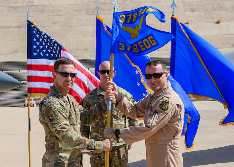 """U.S. Air Force Col. Jason """"Hollywood"""" Smith accepts command of the 378th Expeditionary Operations Group from Brig. Gen. Robert Davis, 378th Air Expeditionary Wing commander, during the group change of command, Prince Sultan Air Base, July 5, 2021. The 378th EOG provides combat power projection in support of U.S. Central Command plans and operations. (U.S. Air Force photo by Senior Airman Samuel Earick)"""