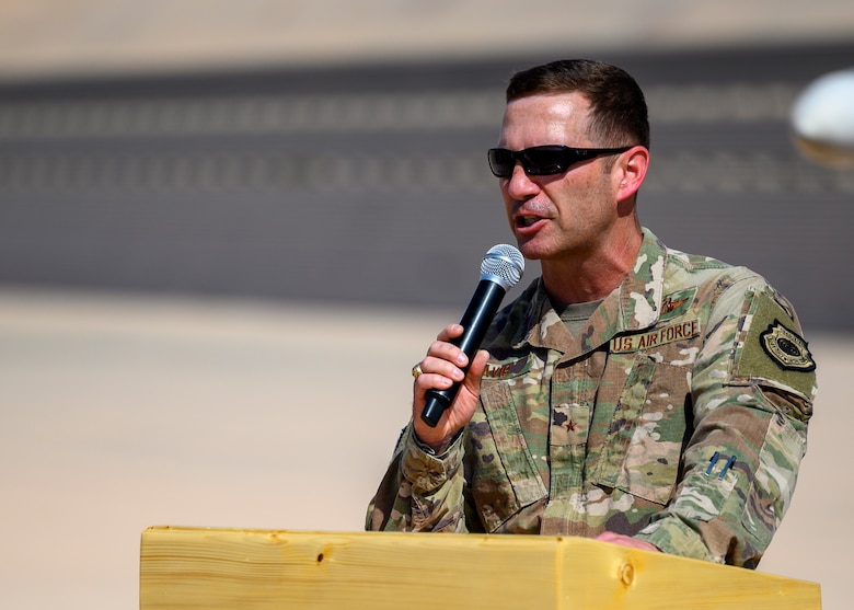 U.S. Air Force Brig. Gen. Robert Davis, 378th Air Expeditionary Wing commander, addresses the audience during the 378th Expeditionary Operations Group change of command ceremony, Prince Sultan Air Base July 5, 2021. The 378th EOG provides combat power projection in support of U.S. Central Command plans and operations. (U.S. Air Force photo by Senior Airman Samuel Earick)
