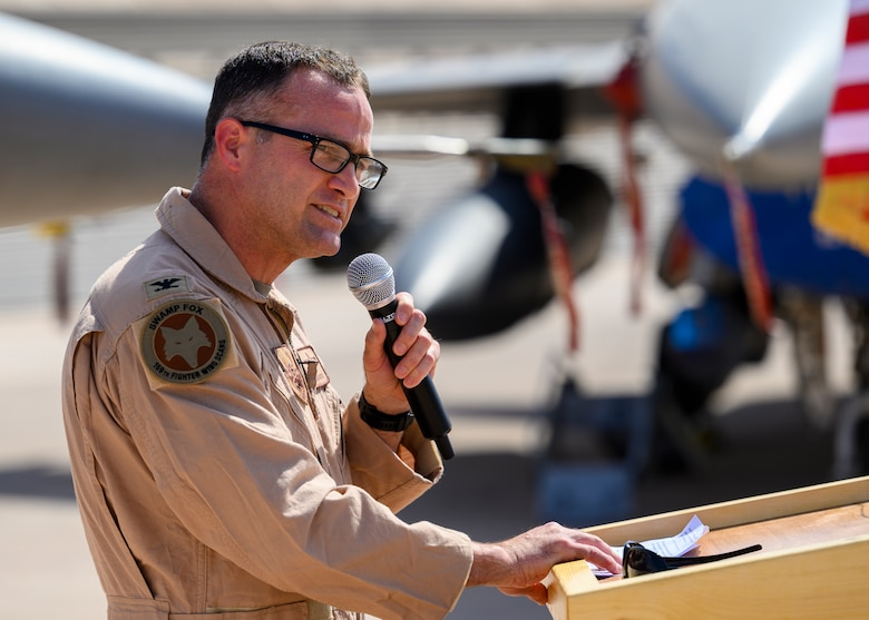 """U.S. Air Force Col. Jason """"Hollywood"""" Smith, incoming 378th Expeditionary Operations Group commander, addresses his unit for the first time during the group change of command, Prince Sultan Air Base July 5, 2021. The 378th EOG provides combat power projection in support of U.S. Central Command plans and operations. (U.S. Air Force photo by Senior Airman Samuel Earick)"""