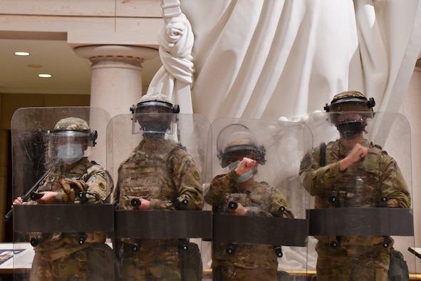 Massachusetts Army and Air National Guardsmen pose for a photo in the Capitol building in Washington, D.C., April 27, 2021. Since January, Army and Air National Guard units from around the country have provided ongoing security, communication, medical, evacuation, logistical and safety support to capital civil authorities. (U.S. Air National Guard photo by Staff Sgt. Hanna Smith)