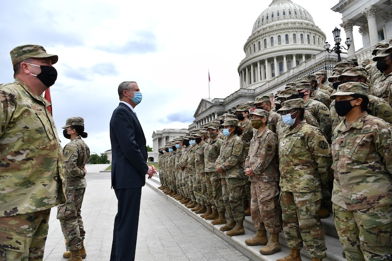 Massachusetts Governor Charlie Baker and Adjutant General of the Massachusetts National Guard Maj. Gen. Gary Keefe thank Soldiers and Airmen of the MA NG for their service in front of the United States Capitol Building in Washington, D.C., May 14, 2021. Since January, Army and Air National Guard units from around the country have provided ongoing security, communication, medical, evacuation, logistical and safety support to capital civil authorities. (U.S. Air National Guard photo by Staff Sgt. Hanna Smith)