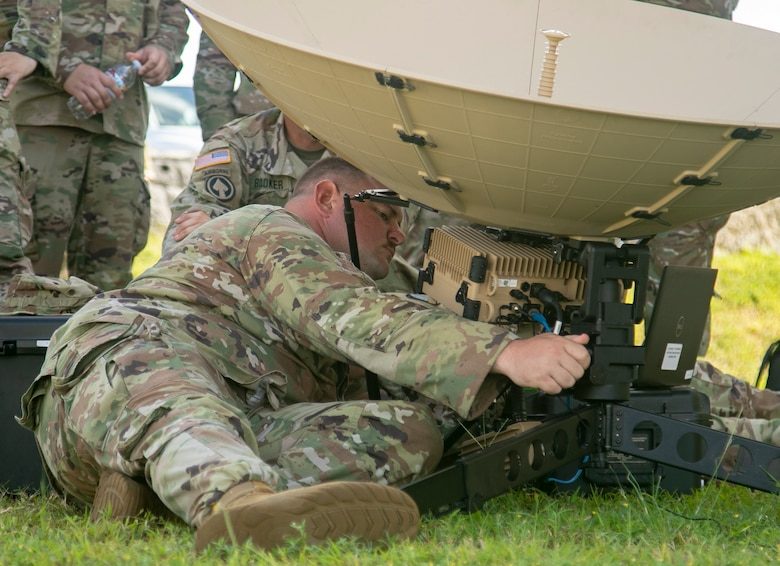 Sgt. Brain Cobb, a multichannel transmission systems operator-maintainer from the 11th Signal Brigade at Fort Hood, makes adjustments to a scalable network node satellite as part of Forager 21, at Andersen Air Force Base, Guam, July 11, 2021. The Army's ability to employ emerging capabilities rapidly and effectively serves as a blueprint for future force structure and employment. (U.S. Army photo by Spc. Richard Carlisi, I Corps Public Affairs)