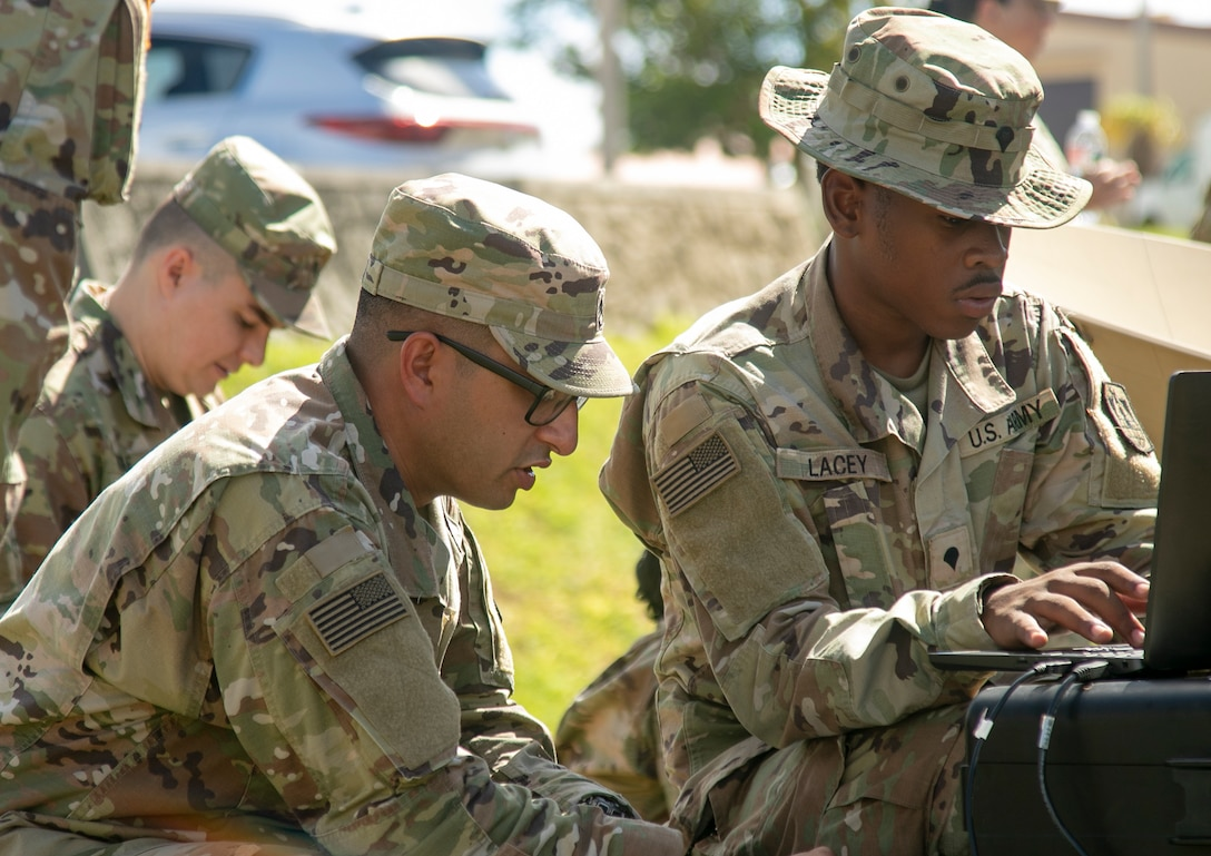 Staff Sgt. Karan Ratra, a satellite communication systems operator, and Spc. Michael Lacey, a multichannel transmission systems operator-maintainer, both from the 11th Signal Brigade, Fort Hood, Tx. set up a scalable network node satellite as part of exercise Forager 21, at Andersen Air Force Base, Guam, July 11, 2021.  Iterative realistic training like this exercise allows the U.S. Army to continuously innovate and practice our ability to dynamically respond with our joint partners, alongside our allies, and partnered militaries across all domains, whether it be land, air, sea, cyber or space.