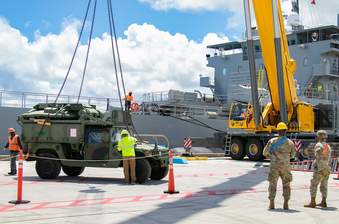America's First Corps Soldiers and civilian contractors unload military vehicles from the United States Army Vessel Lt. Gen. William B. Bunker, 8th Theater Sustainment Command, in support of Forager 21, at Naval Base Guam, July 10, 2021. Army Watercraft Systems provide strategic movement support to the Joint Force and are integrated with the Pacific Fleet's maritime operation center. (U.S. Army photo by Spc. Richard Carlisi, I Corps Public Affairs)