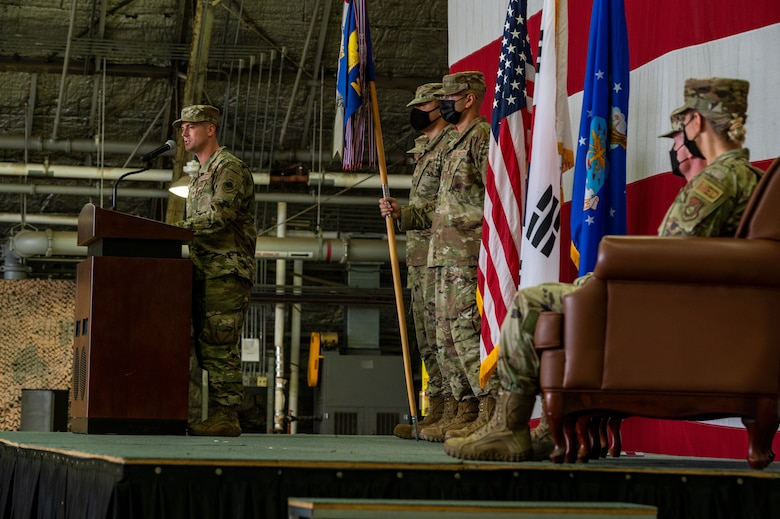 Col. Michael Fea, 51st Medical Group outgoing commander and Col. Jennifer Vecchione, 51st Medical Group incoming commander, listen to opening remarks from Col. Joshua Wood, 51st Fighter Wing commander, left, during the 51st Medical Group change of command ceremony at Osan Air Base, Republic of Korea, July 12, 2021. As the presiding officer, Wood facilitated the transition of 51st MDG command. (U.S. Air Force photo by Tech. Sgt. Nicholas Alder)