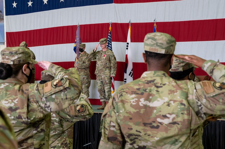 Col. Michael Fea, 51st Medical Group outgoing commander, returns a salute to his squadron during the change of command ceremony at Osan Air Base, Republic of Korea, July 12, 2021. The ceremonial passing of the guidon from Fea marks the official end of his command of the 51st MDG. (U.S. Air Force photo by Tech. Sgt. Nicholas Alder)