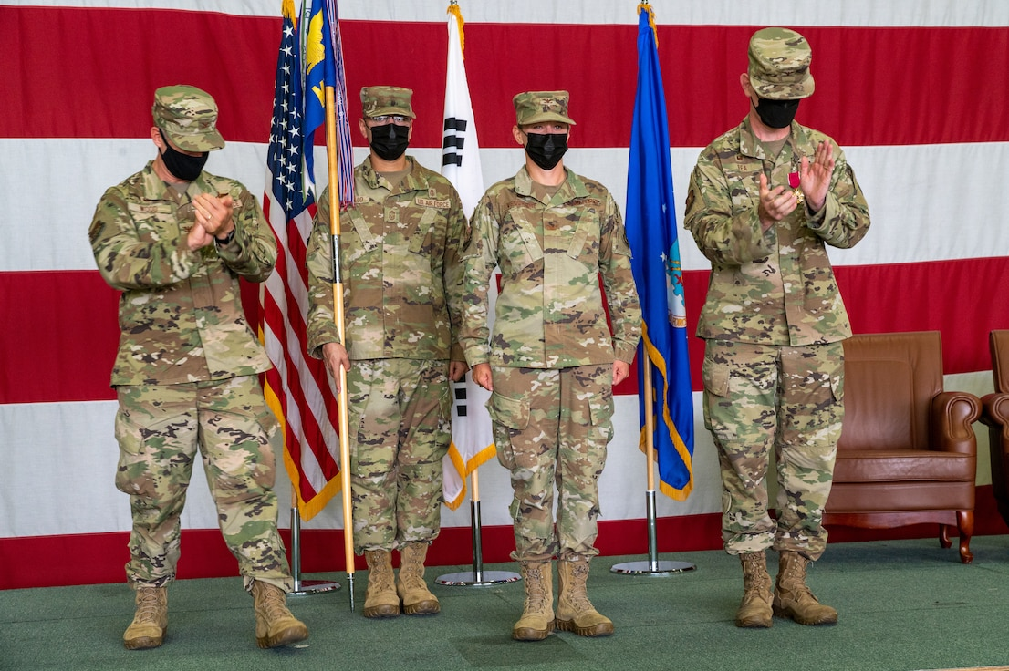 Col. Jennifer Vecchione, 51st Medical Group commander, center right, receives applause during the 51st Medical Group change of command at Osan Air Base, Republic of Korea, July 12, 2021. The change of command ceremony is deeply rooted in military tradition that dates back to the reign of King Frederick of Prussia and has persisted into modern day. (U.S. Air Force photo by Tech. Sgt. Nicholas Alder)