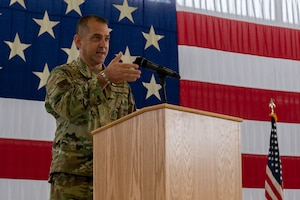 A commander standing behind a podium.