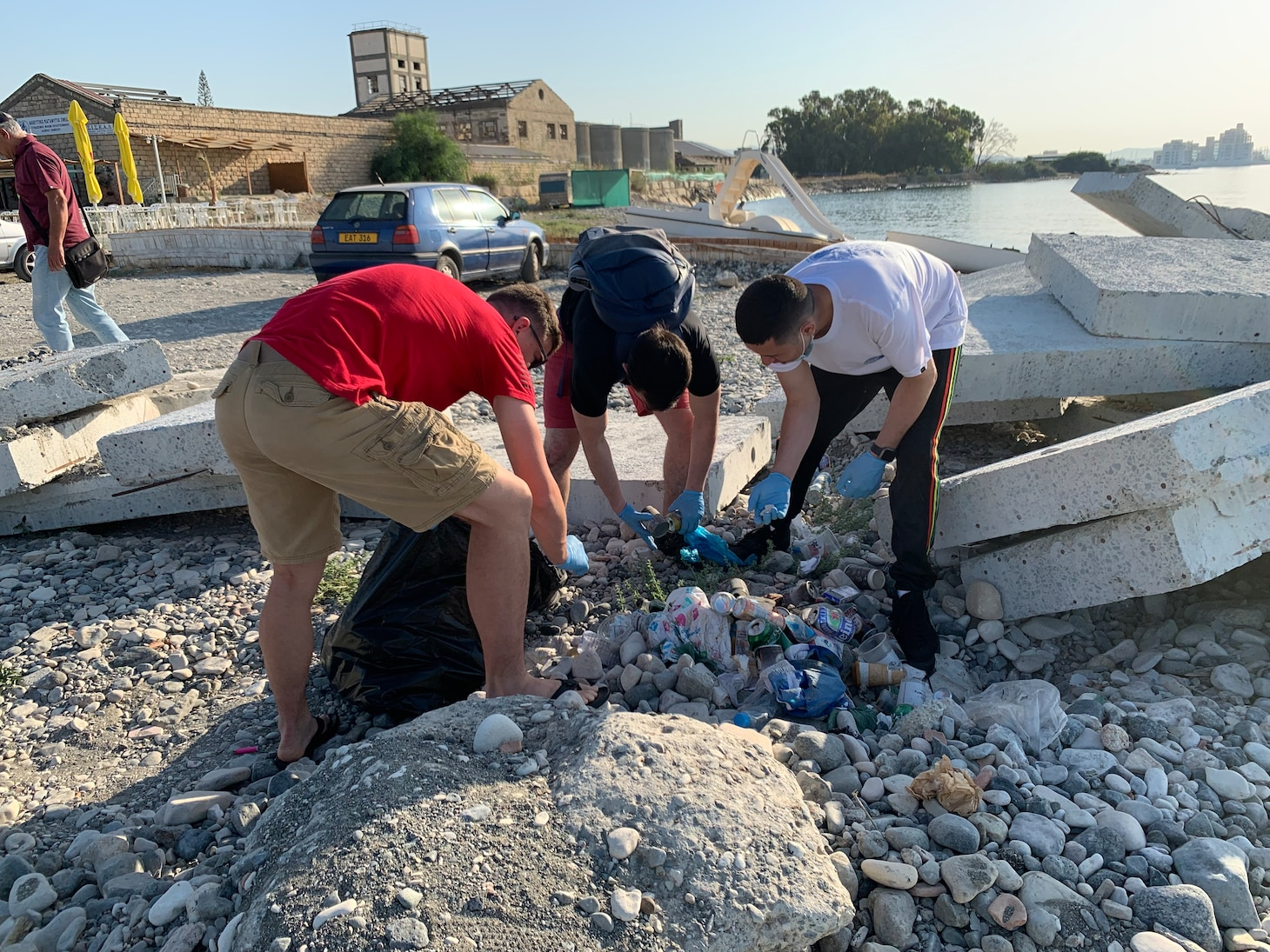 Sailors from Arleigh-Burke class guided missile destroyer USS The Sullivans (DDG 68) participate in a beach cleanup during a scheduled port visit in Limassol, Cyrpus, July 08, 2021.  The Sullivans is on a scheduled deployment with Carrier Strike Group 21. U.S. Sixth Fleet, headquartered in Naples, Italy, conducts the full spectrum of joint and naval operations, often in concert with allied and interagency partners, in order to advance U.S. national interests and security and stability in Europe and Africa.