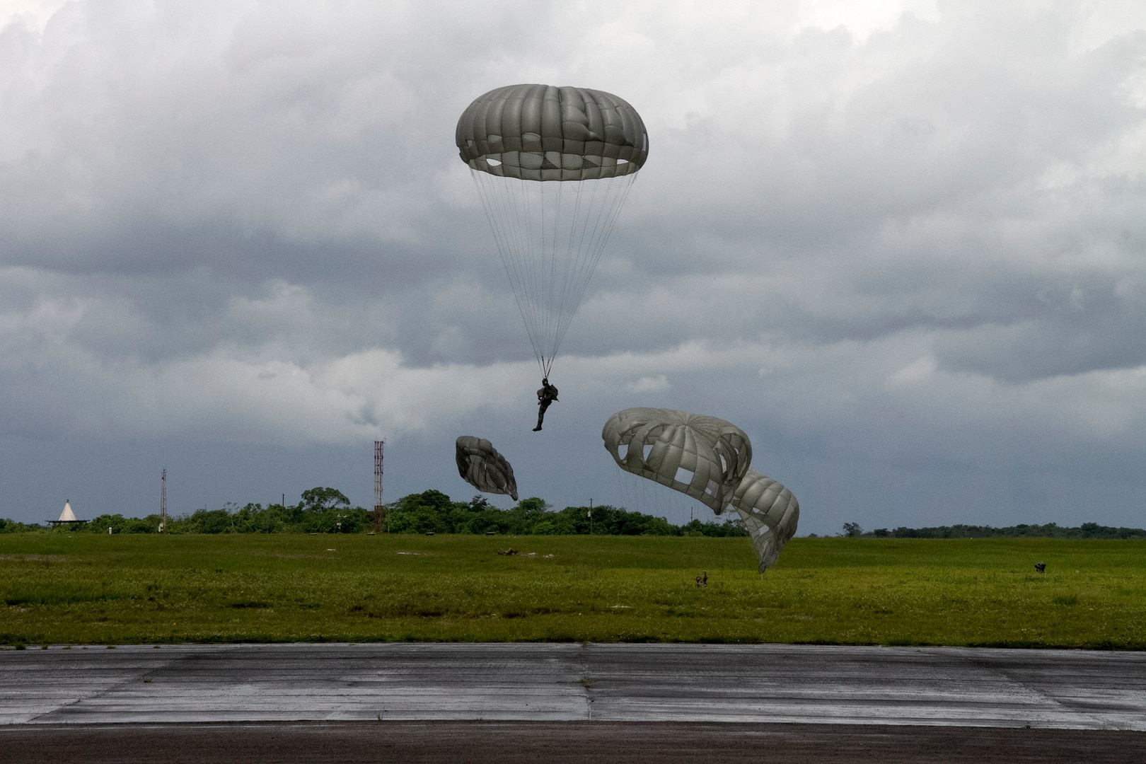 A Soldier participating in a Tradewinds 21 combined forces jump prepares to land at Airbase London, Guyana, June 20, 2021. Tradewinds 21 is a U.S. Southern Command-sponsored Caribbean security exercise with partner nations in the ground, air, sea and cyber domains.