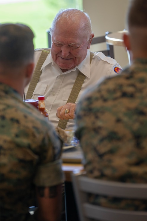 Retired U.S. Marine Corps Sgt. Lee Reed speaks with Marines from 3rd Battalion, 2d Marine Regiment (3/2), 2d Marine Division, about his experiences during World War II during a Warrior's Breakfast at Camp Lejeune, N.C., July 9, 2021. Reed, who served in World War II while assigned to 3/2, visited the Marines to see how weapons and equipment have evolved, as well as to pass off wisdom and share his experiences. (U.S. Marine Corps photo by Lance Cpl. Reine Whitaker)