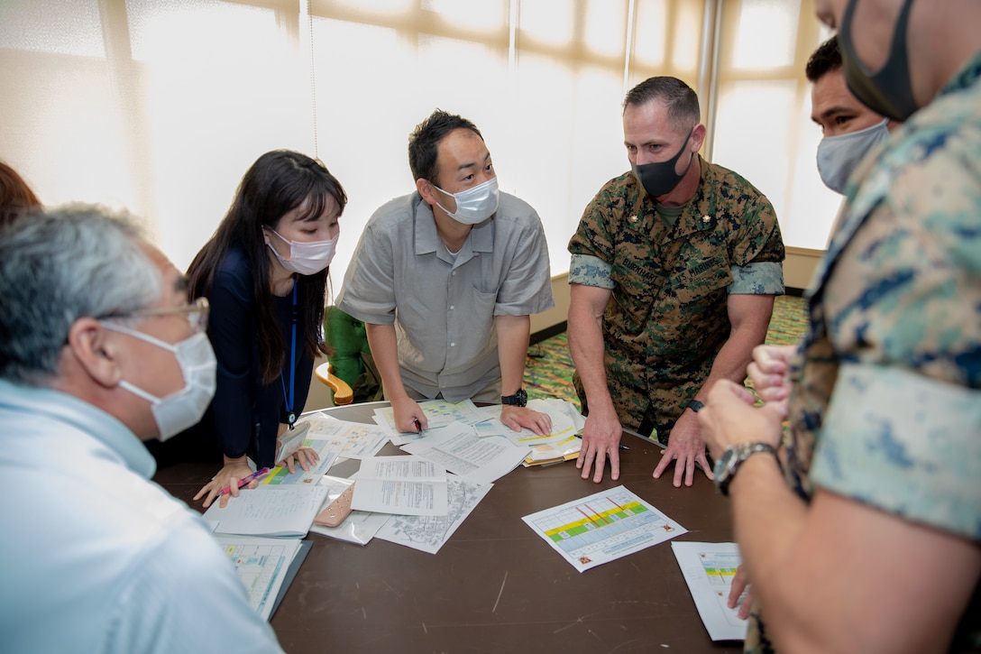 Japanese government officials and U.S. Marines come together for discussions during the Artillery Relocation Training Program Annual Planning Conference on Camp Hansen, Okinawa, Japan, June 22, 2021. The ARTP Annual Conference allows Japanese and U.S. officials to develop a better understanding of the goals of the program, as well as solidify bilateral objectives related to the training, the continued usage of training areas and the modernization of both forces.