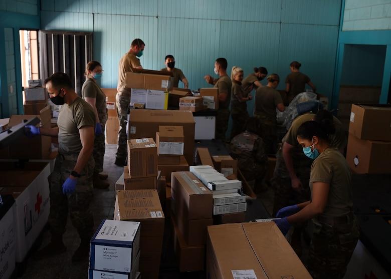 A team of U.S. military medics take inventory of supplies at Hospital del Sur in Choluteca, Honduras.