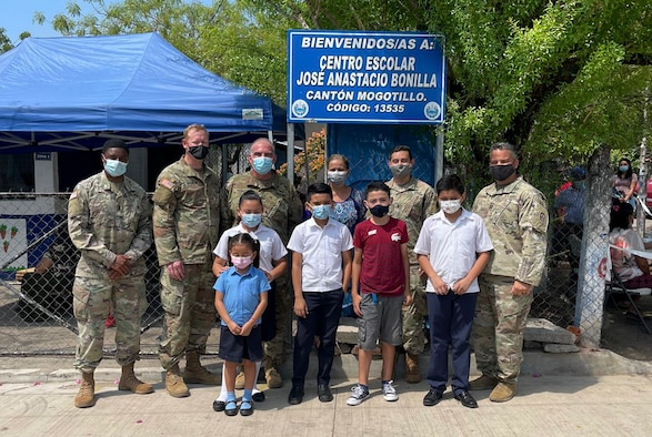 U.S. Army Soldiers with Joint Task Force-Bravo, Soto Cano Air Base, Honduras, donate construction materials to a school in Mogotillo, El Salvador.