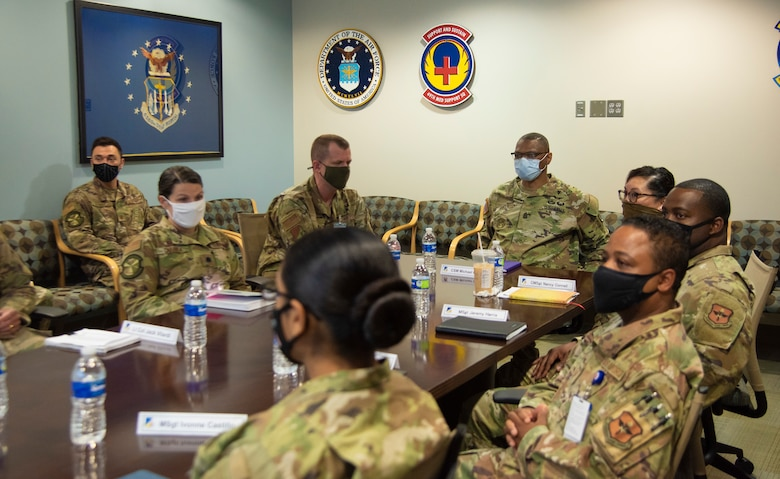 Command Sgt. Maj. Michael Gragg, Defense Health Agency senior enlisted leader, and 49th Medical Group leadership sit through a leadership in-brief, June 30, 2021, on Holloman Air Force Base, New Mexico. Gragg visited the 49th MDG to discuss the current state of the DHA and to address any areas of concern. (U.S. Air Force photo by Airman 1st Class Jessica Sanchez)